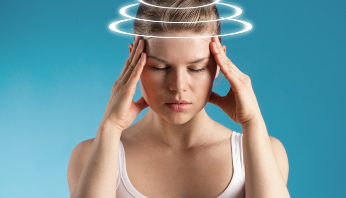 Woman with vertigo. Young patient suffering from dizziness