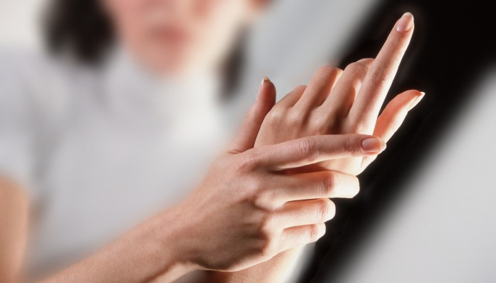 2000 --- Woman Rubbing Her Hands --- Image by © Royalty-Free/Corbis