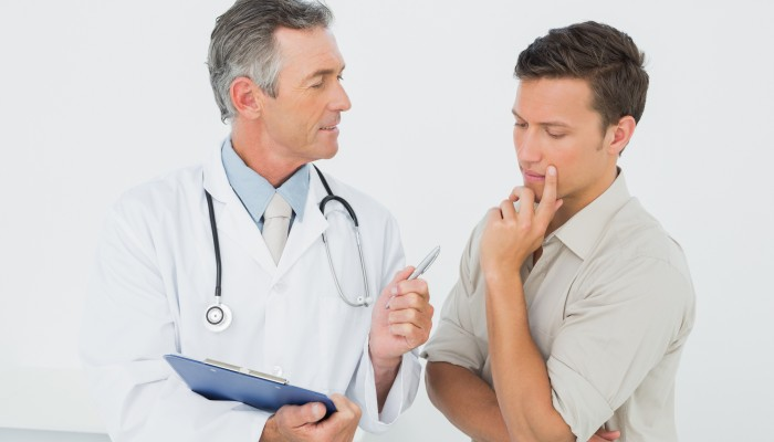 Male doctor in conversation with patient in the medical office