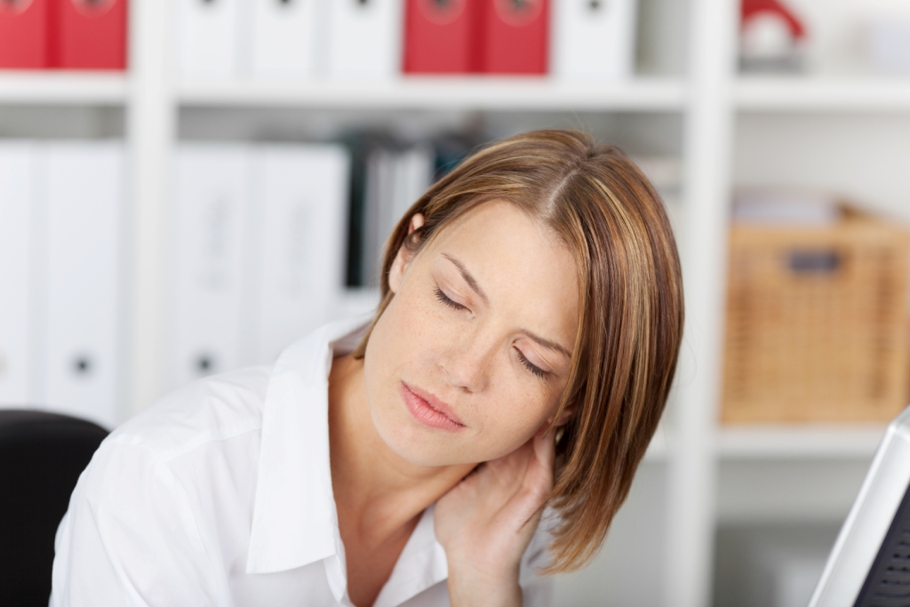 Woman with a stiff painful neck